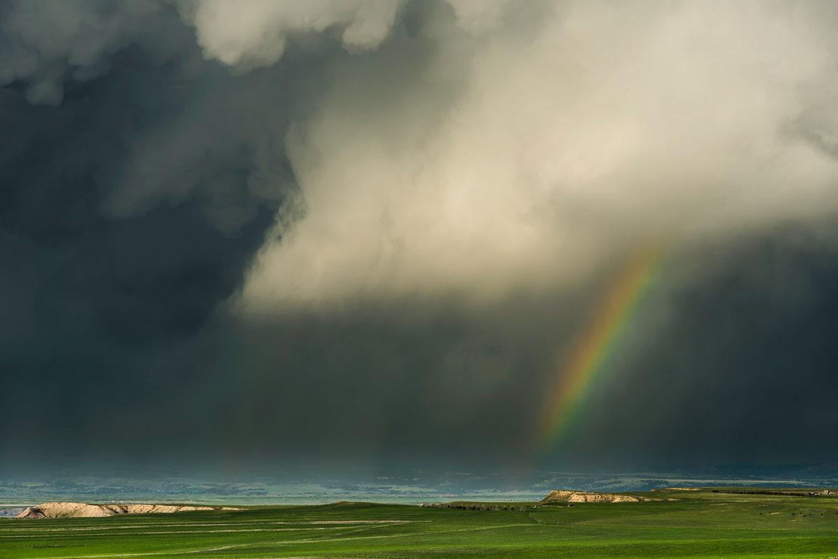 Rainbow and Rainstorm. Oglala Grasslands, Nebraska – Eric Meola