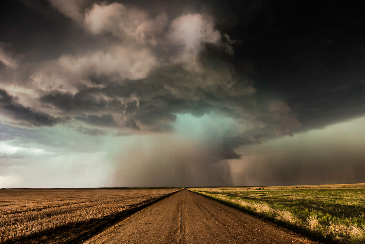 Road with Supercell. Strasburg, Colorado – Eric Meola